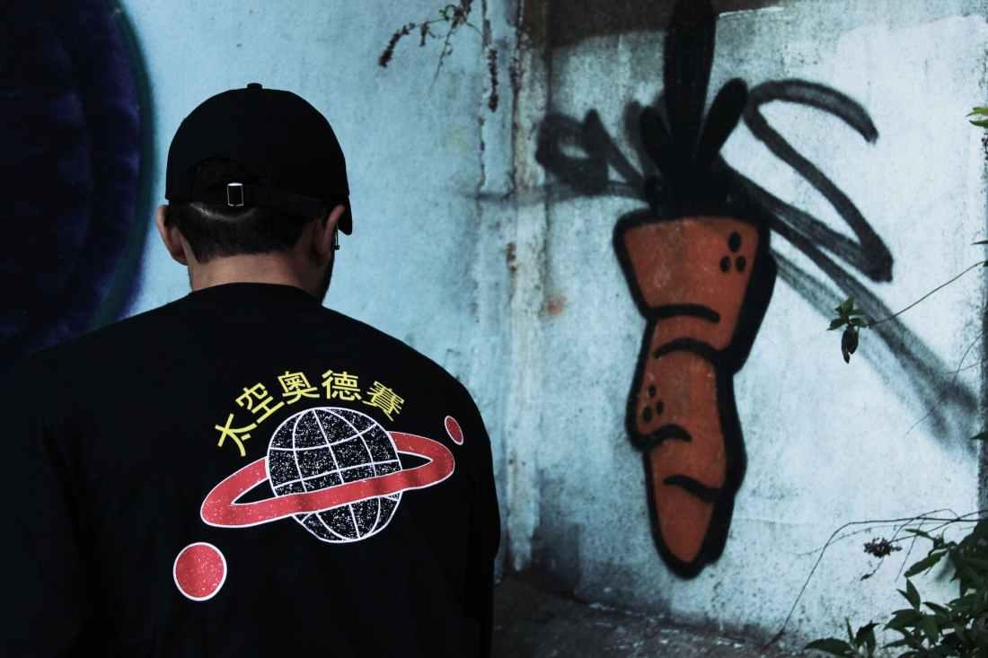 person looking at graffiti